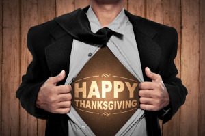 Business man tears open his shirt in a super hero fashion with happy thanksgiving writing