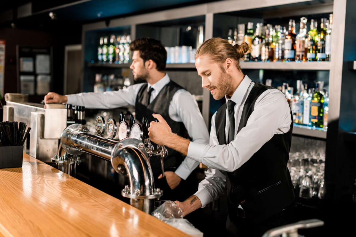 Barmen Working At Bar